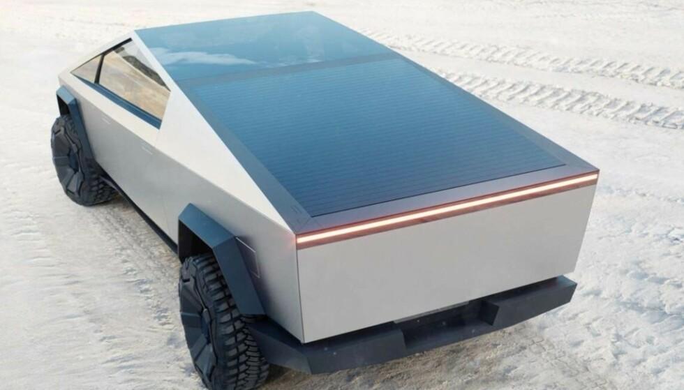 TREKK: Cybertruck har et eget bagasjeromsdeksel som rulles vekk. Foto: Tesla
